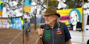 Graeme Dunstan with protest banners at Independence from America Day SpeakOut at Western Street Barracks, Rockhampton: 4th of July