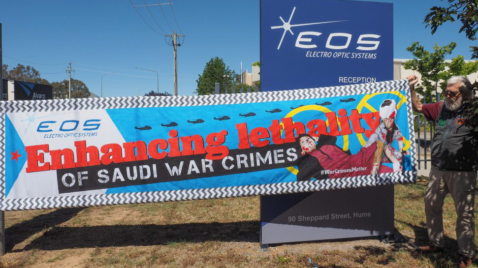 Protest banner at EOS Canberra