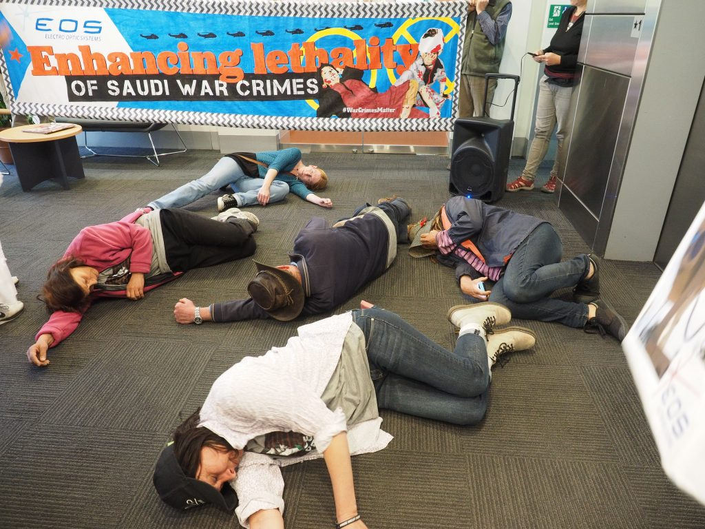 'Victims' of the arms trade die-in in the foyer of the ACT Government offices