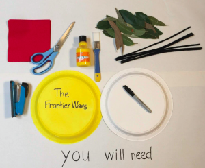 Red paper, serviette or crepe paper, scissors, yellow paint, paintbrush, real leaves, black pipe cleaners/shoelaces or similar, stapler, paper plate or cardboard, marker.
