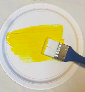 Paint the back of a paper plate yellow